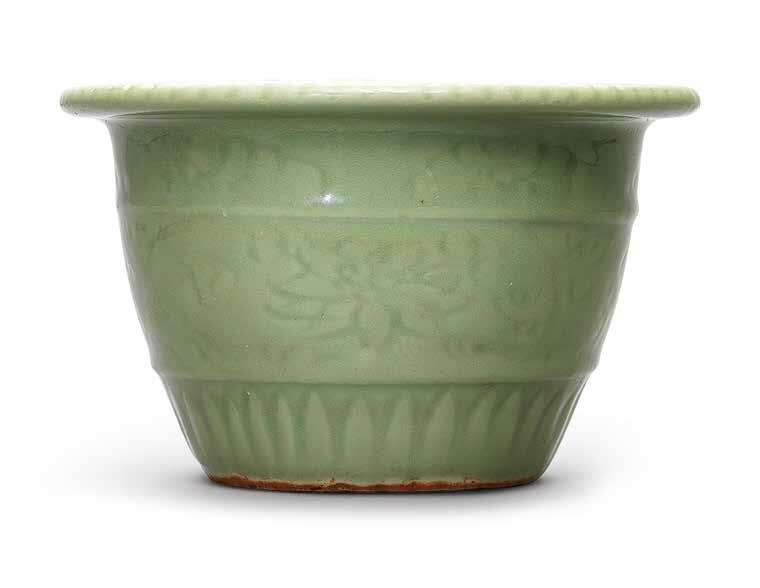 A carved Longquan celadon 'Lotus' flower pot, Ming dynasty, 15th century