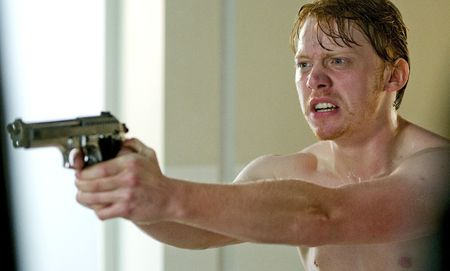 Rupert_Grint_Tony_mid_shot_angrily_holding_gun_in_bathroom_0407_Photo