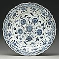 A blue and white barbed rim 'floral scroll' dish, ming dynasty, yongle period
