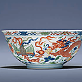 A fine and extremely rare wucai 'Dragon and Phoenix' bowl, Yongzheng six-character mark in underglaze blue within a double circle and of the period (1723-1735)