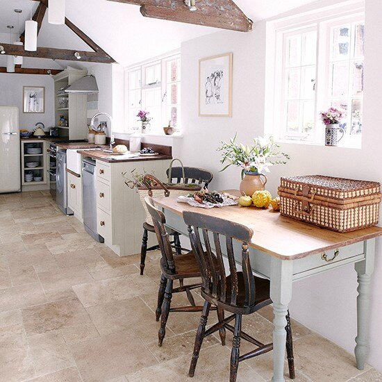 Limestone-flooring-in-kitchen-with-stone-painted-units-and-farmhouse-table--Country-Homes-and-Interiors--Housetohome