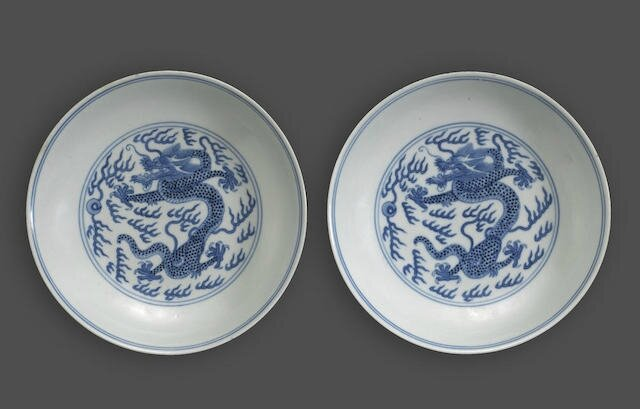 A pair of blue and white dragon-decorated dishes, Daoguang six-character marks and of the period