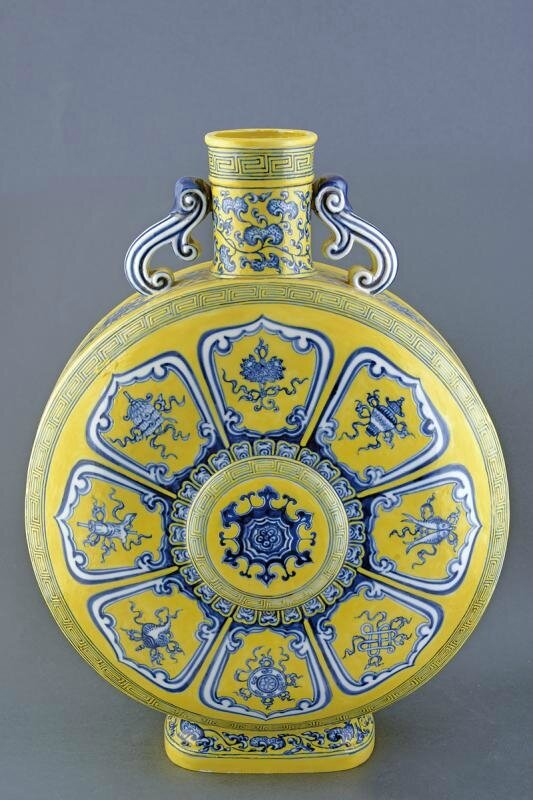 A big yellow ground bajixiang porcelain moon flask, Qing dynasty (1644-1911), late 19th century