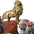 An italian silver-gilt figure of a lion on hardstone base, buccellati, second half 20th century