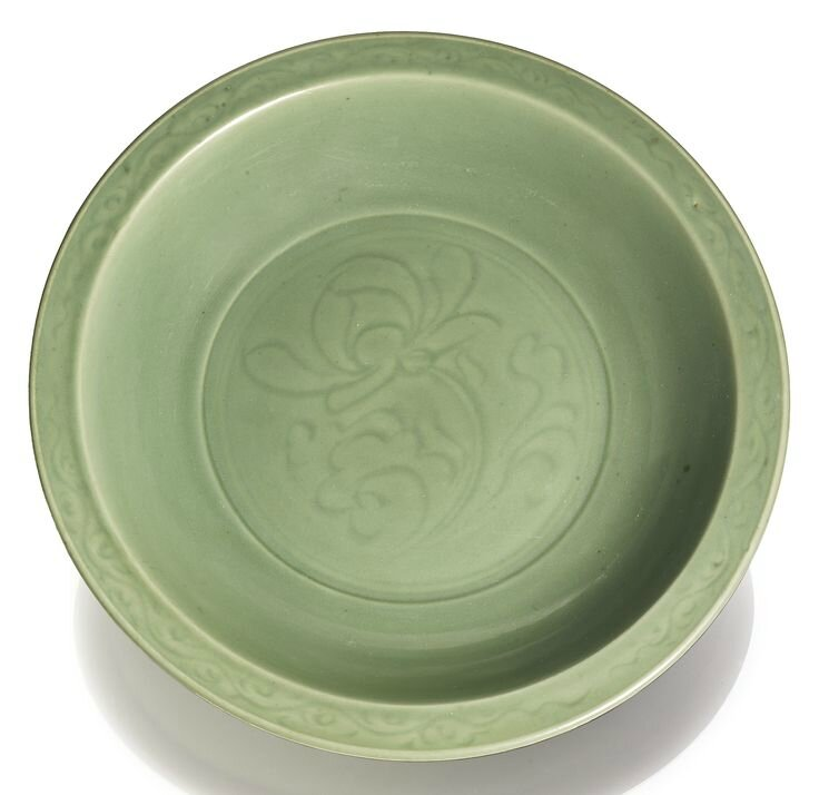 A large 'Longquan' celadon 'Lotus' dish, Ming dynasty, 15th-16th century