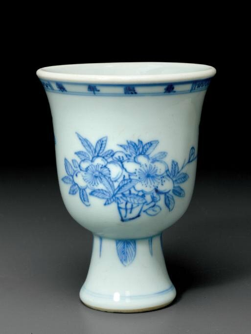 A blue and white stem cup, Kangxi four-character mark in underglaze blue in a line and of the period (1662-1722)