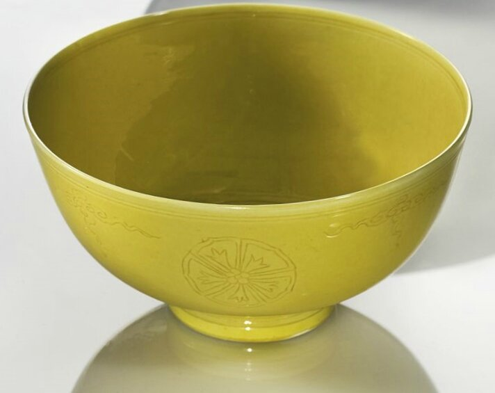 A yellow-glazed incised bowl, Kangxi mark and period