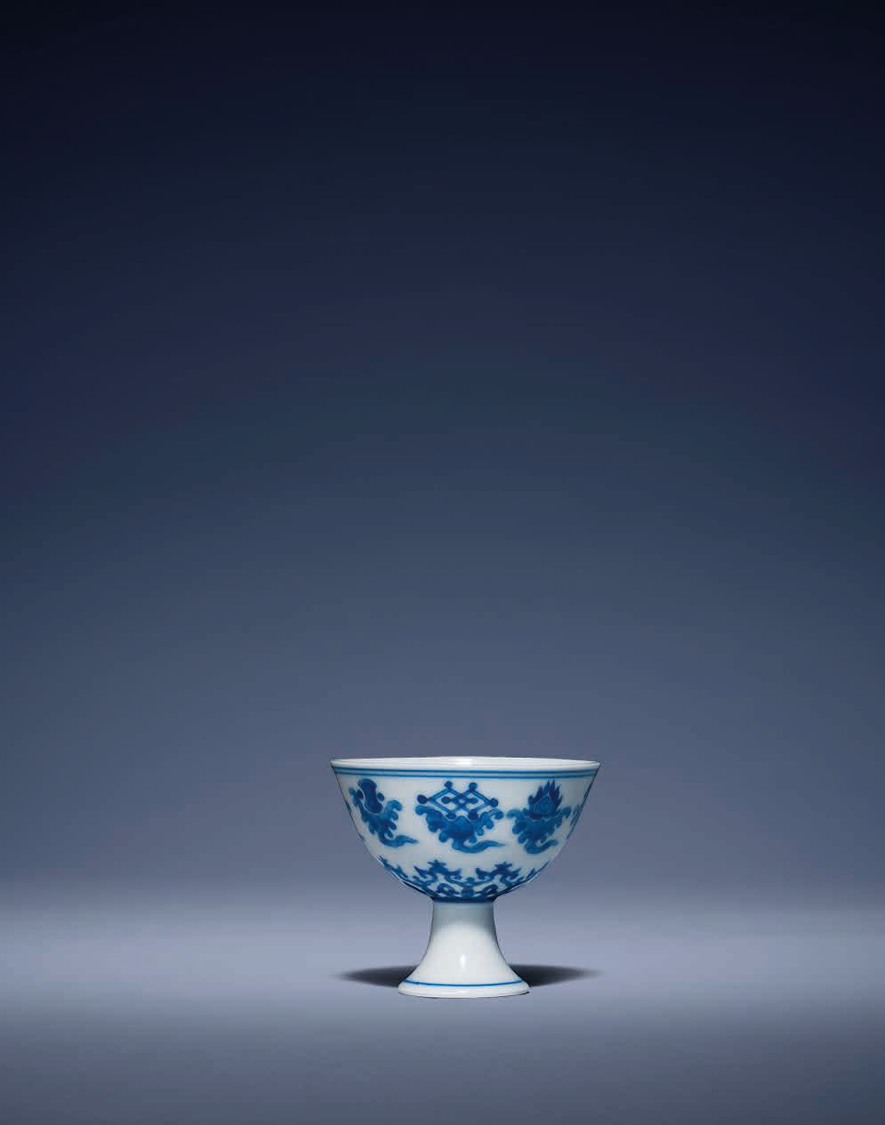 A fine and rare miniature blue and white 'babao' stem cup, Qianlong six-character seal mark in a line and of the period (1736-17
