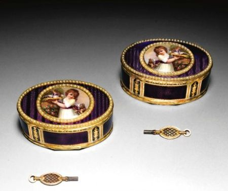A_pair_of_gold_and_purple_enamel_singing_bird_boxes__made_for_the_Chinese_market__the
