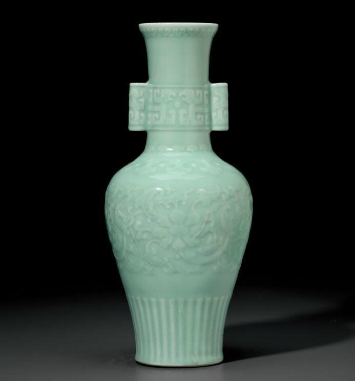 A rare celadon-glazed relief-decorated baluster vase, Qianlong six-character seal mark in underglaze blue and of the period