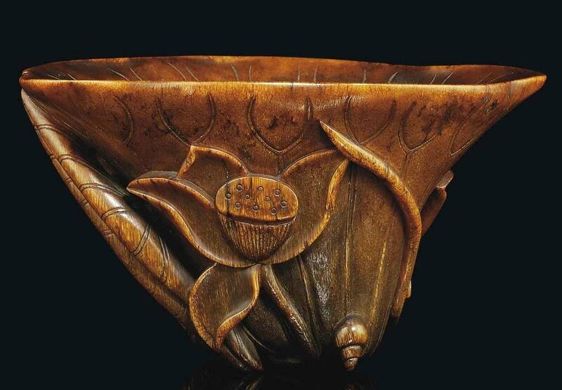 A rare well-carved rhinoceros horn 'Lotus' libation cup, 17th century