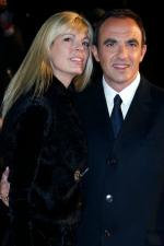 tv-host-nikos-aliagas-and-his-wife-arrive-at-the-cannes-festival-palace-to-attend-the-nrj-music-awards-in-cannes_5155569