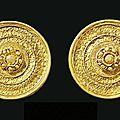 A pair of etruscan gold ear studs, circa 530-500 b.c.