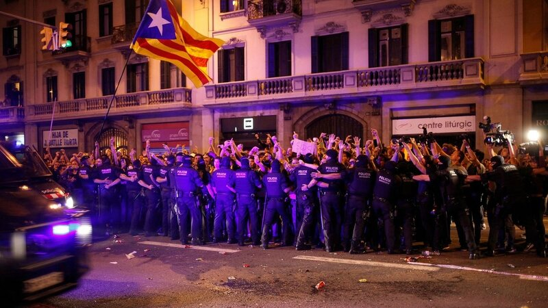 demonstrators-are-stopped-by-catalan-mossos-d-esquadra-officers-while-spanish-national-police-officers-leave-their-headquarters-in-a-van-in-bar