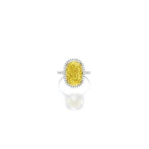 Fancy Vivid Yellow Diamond and Diamond Ring