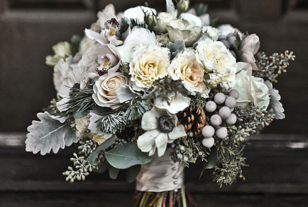 mini-cymbidium-orchids-silver-brunia-juniper-sprigs-pine-boughs-anemones-pinecones-garden-spray-roses-seeded-eucalyptus-Vendela-roses-and-dusty-miller-629x424