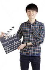 stock-photo-asian-man-holding-movie-clapper-isolated-on-white-287676623