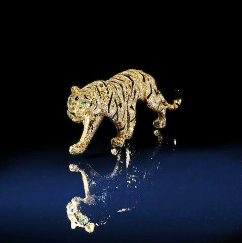 "A coloured diamond and diamond ""Tiger"" brooch, by Cartier, circa 1990"