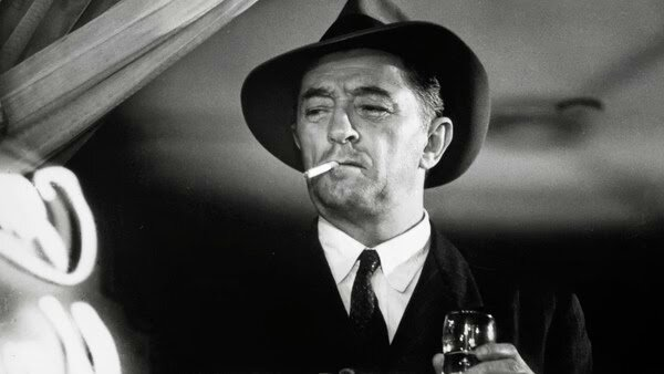 RobertMitchum As Philip Marlowe