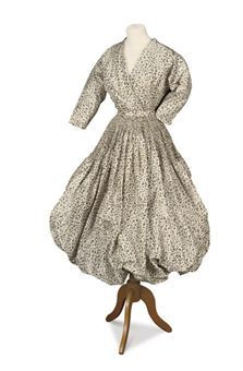 A grey and white puff-ball dress. Eisa, circa 1951. Image 2009 C