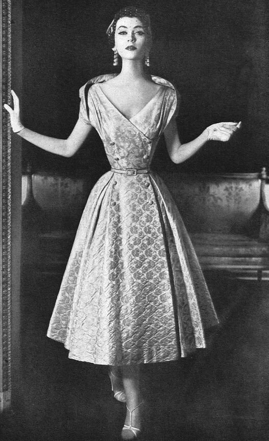 Dovima in brocade dinner dress by Adele Simpson, 1953