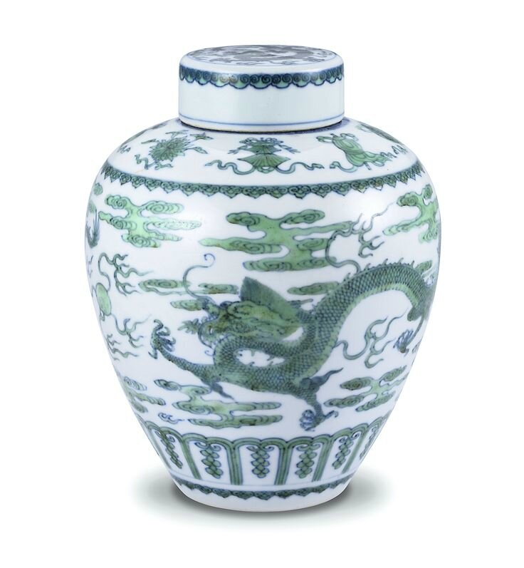A green-enamelled 'dragon' jar and cover ; jar: Mark and period of Kangxi ; cover: Qing dynasty, Qianlong period