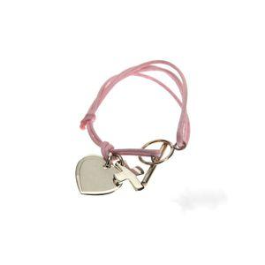 bracelet_croix_et_breloque