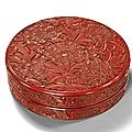 A superbly carved cinnabar lacquer box and cover, yongle incised six-character mark and of the period (1402-1425)