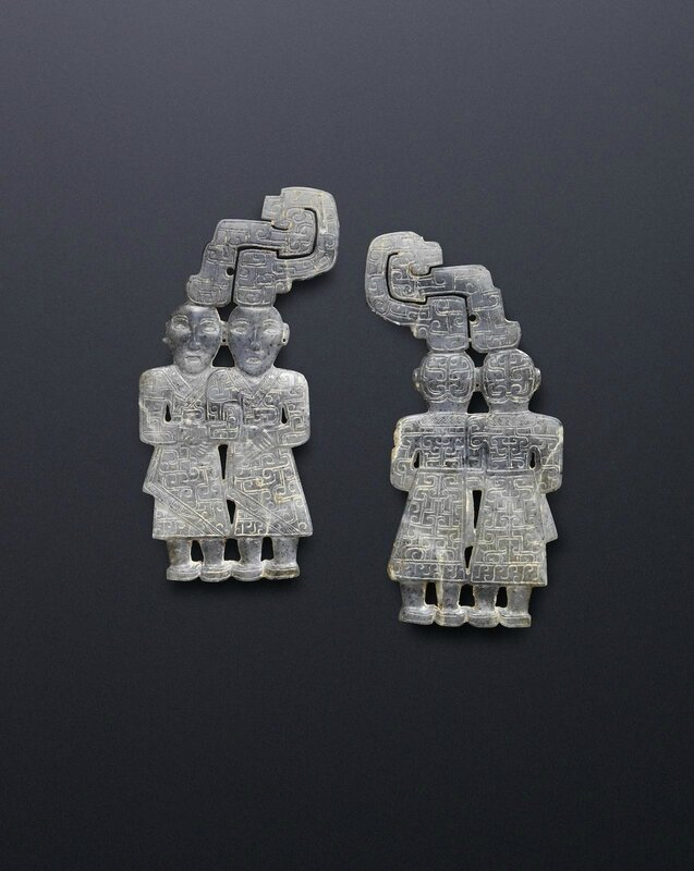 A very rare pair of grey jade 'twins' pendants, Warring States Period or later