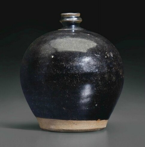 A blackish-brown and russet-glazed ovoid bottle, China, Jin-Yuan Dynasty, 13th Century