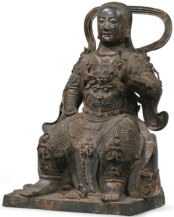 A large finely-cast gilt-lacquered bronze figure of Zhenwu, China, Ming dynasty
