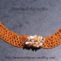 Collier coquillage orange tissage de perles