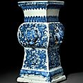 A very rare blue and white relief-molded vase, fanggu, Wanli six-character mark in underglaze blue in a line and of the period (1573-1619)