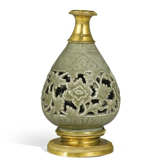 A rare gilt-bronze mounted and reticulated 'Longquan' celadon bottle vase, Ming dynasty