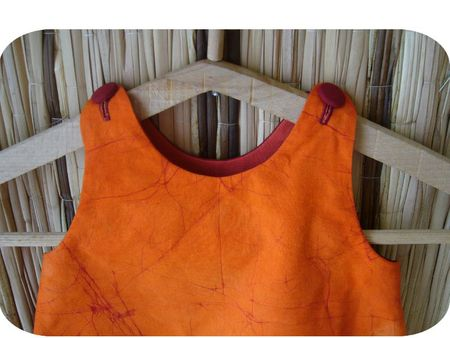 ROBE TOURNICOTI orange rouge encolure