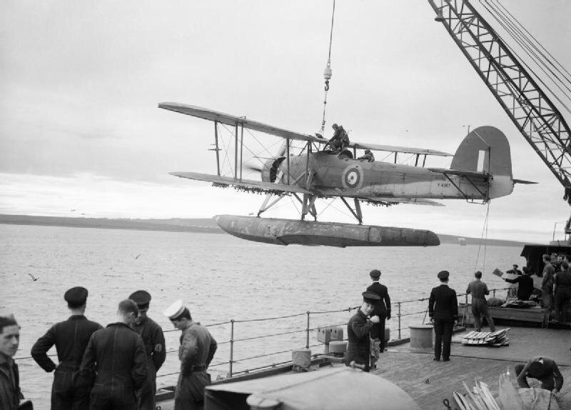 A_Fairey_Swordfish_being_hoisted_aboard_HMS_MALAYA,_October_1941__A5694