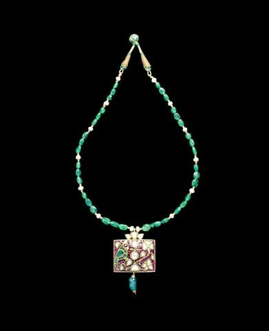 An Indian gem-set pendant on emerald and pearl string