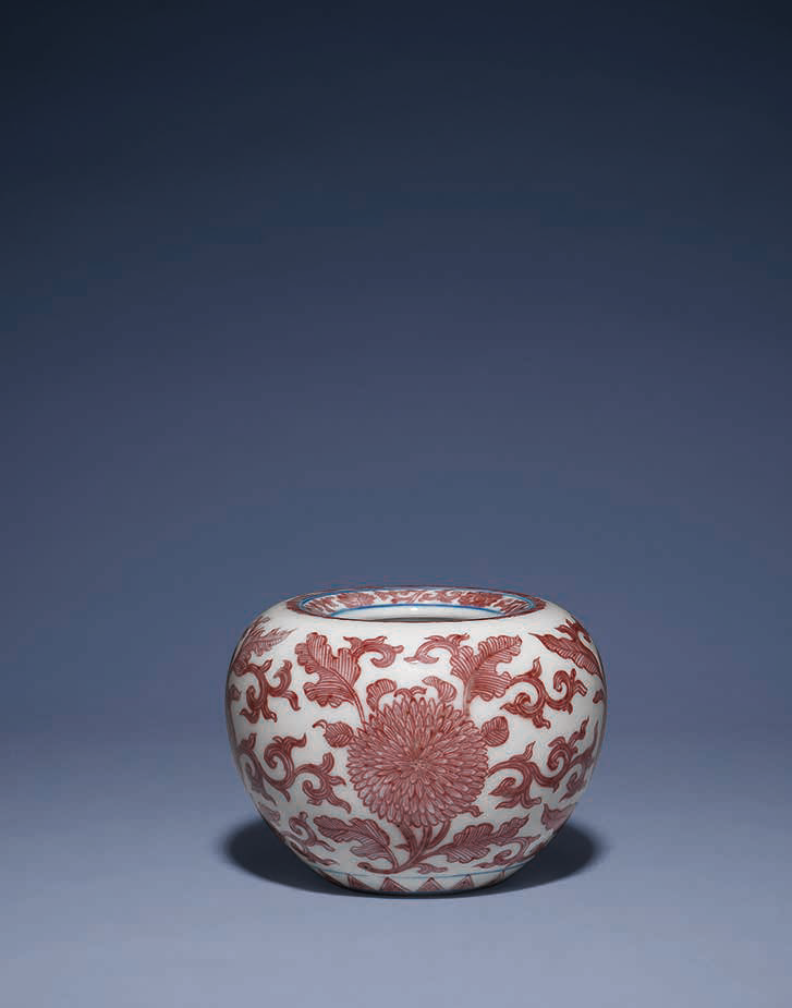 A copper red and underglaze blue-decorated apple-shaped waterpot, Kangxi six-character mark in underglaze blue and of the period