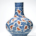 An iron-red and underglaze-blue 'bats and clouds' vase, qing dynasty, 19th century