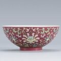 A ruby-ground famille-rose floral bowl, caixiu tang mark, qing dynasty, 18th century