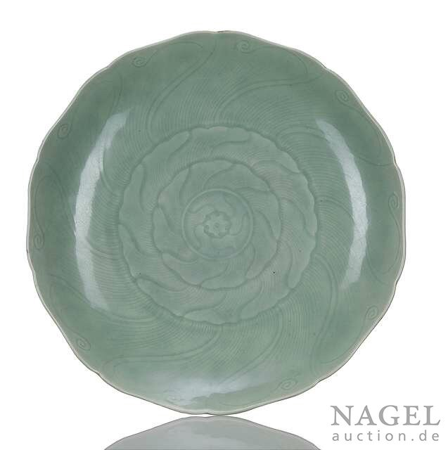 A large celadon-glazed blossom-shaped porcelain plate, China, 18th century