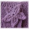 Fleur boutonnière au tricot