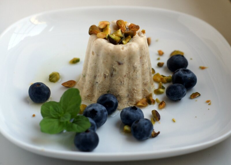 Spice and pistachio Indian kulfi and blueberries