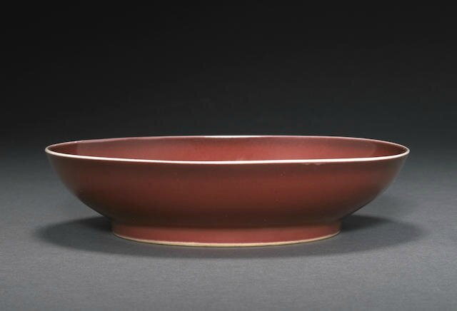 A copper red glazed deep dish, Qianlong six-character mark and of the period