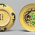 A pair of yellow-ground green and aubergine-enameled 'dragon' dishes, Guangxu marks and period
