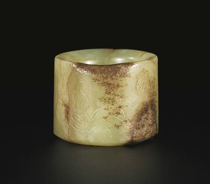 A rare Imperial yellow jade archer's ring inscribed with a poem by the QIanlong emperor, Qing dynasty, Qianlong period 2