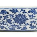 A blue and white 'floral scoll' bowl, qianlong seal mark and period