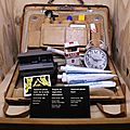James Bond's suitcase created by Q containing (among others) a Polaroid laser camera and an explosive pack of cigarettes. « Licence to Kill » 1989. Photo: Olivier Daaram Jollant © 2016
