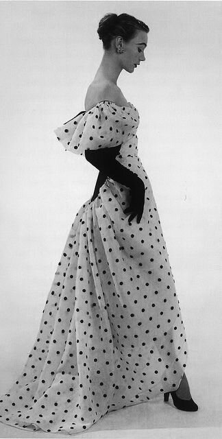 Balenciaga, 1952 Sophie Malgat is wearing an evening dress of white organdie embroidered with black polka-dots