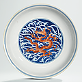 An iron-red and underglaze-blue decorated 'dragon' dish, qianlong six-character seal mark in underglaze blue and of the period
